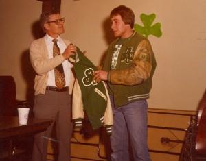 1979 St. Pats Board Representative receiving a new Jacket