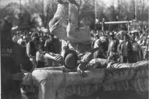 1982 Man performing a backflip into Alice