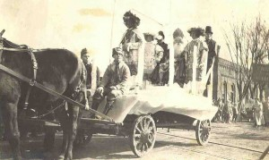 St. Pat and his Court riding on wagon